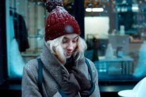 girl on a winter walk in the city, snow, outside. Winter street in the city.