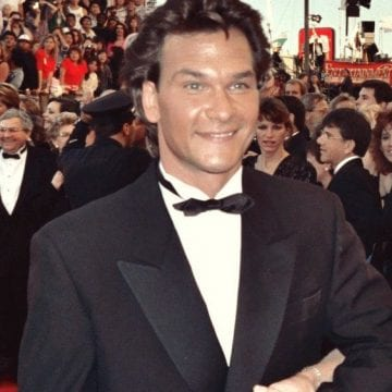 Famous alcoholic Patrick Swayze smiling on red carpet