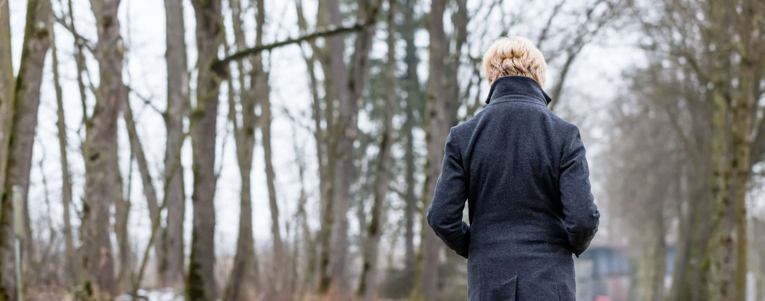 Seasonal affective disorder lack of vitamin D Unhappy woman having walk in winter