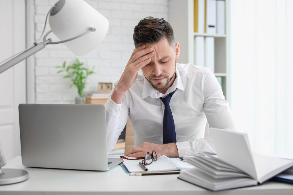 Man suffering from tension headache anxiety