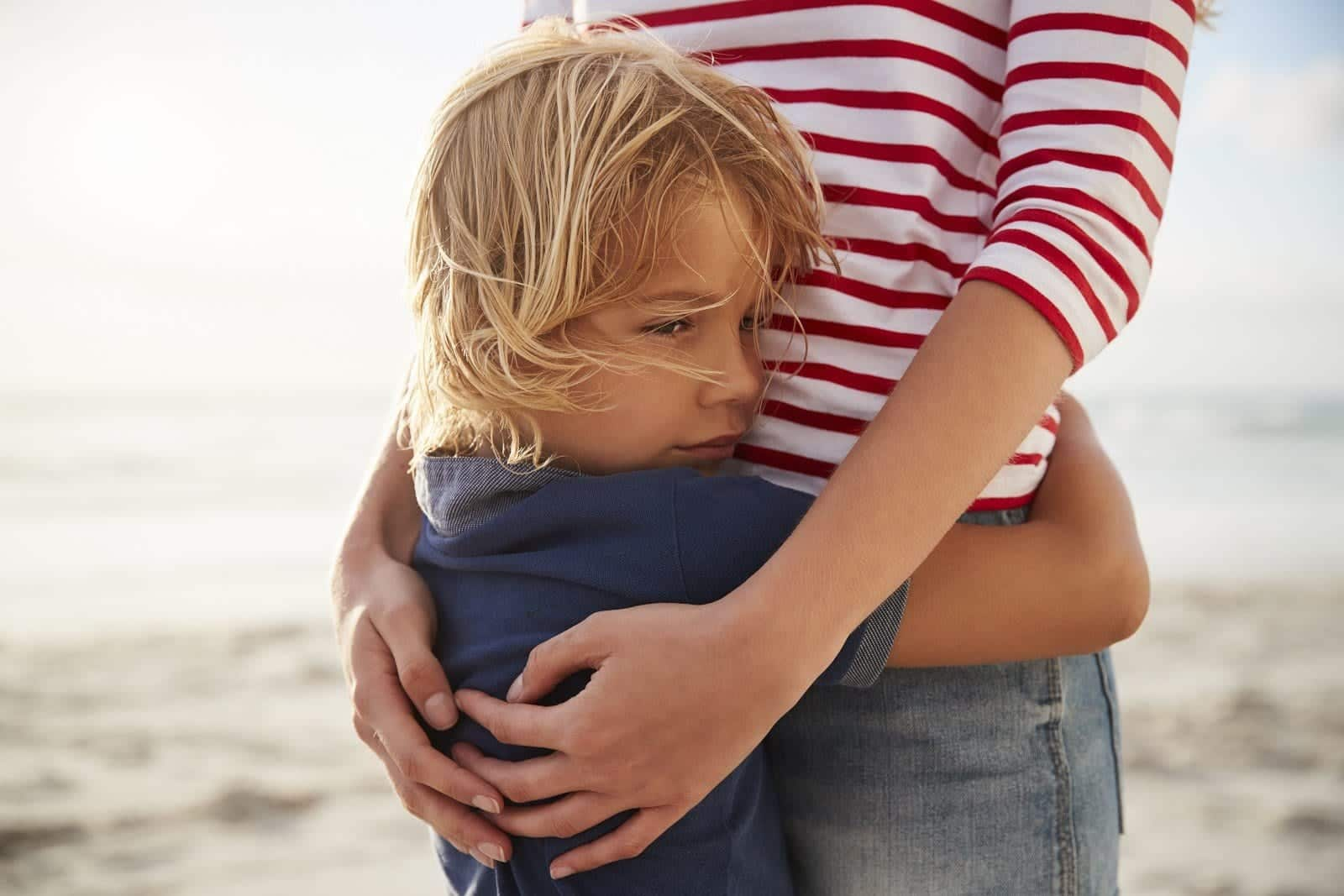 mom hugging boy