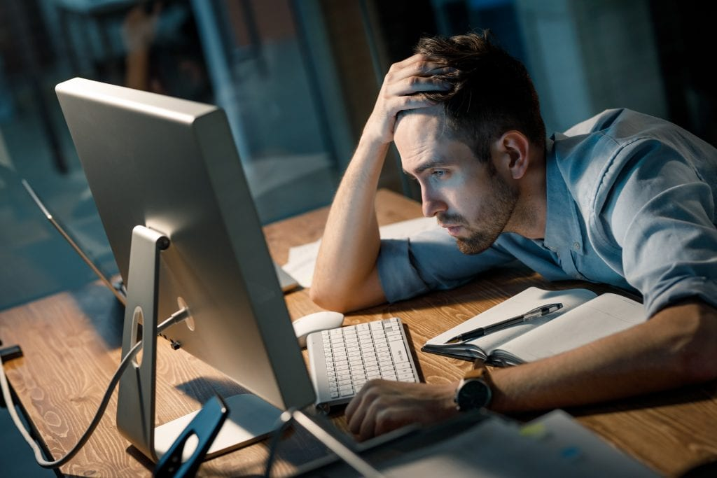 adrenal Fatigue stress man working late in office