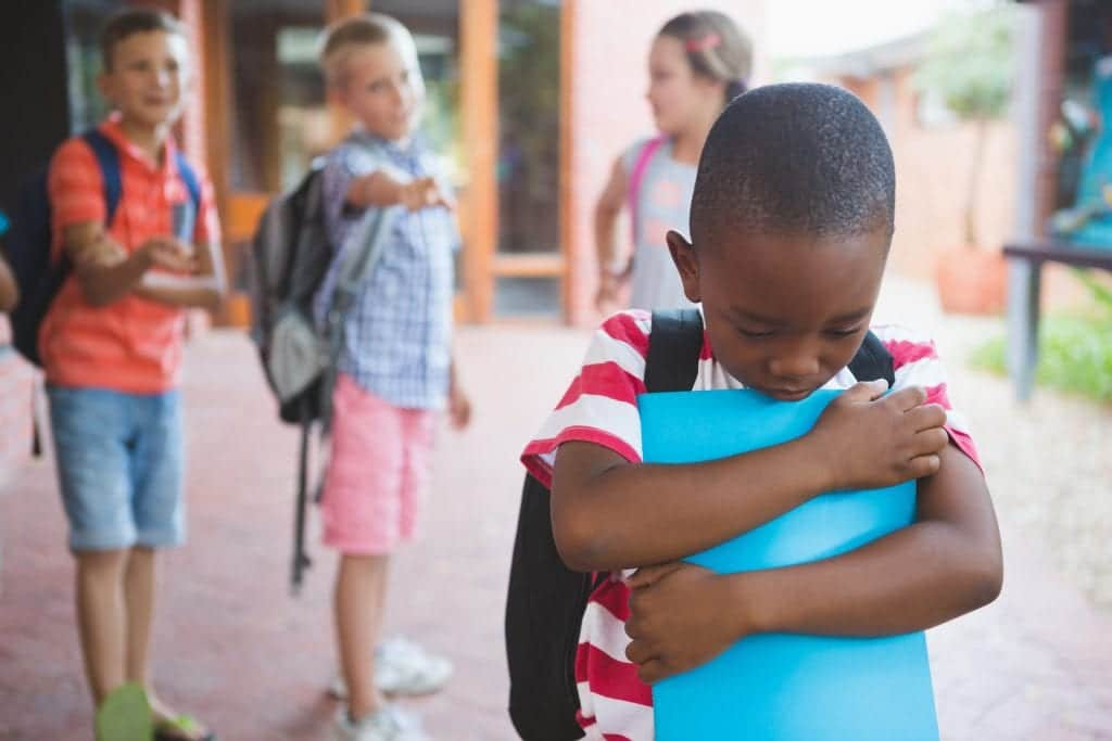 young boy dealing with bullying at school