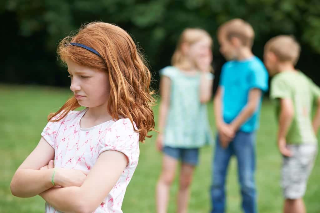 young girl dealing with bullying from other children